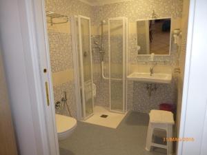 Koupelna v ubytování Hotel Madison