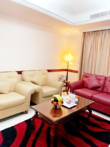 A seating area at Hala Inn Hotel Apartments - BAITHANS