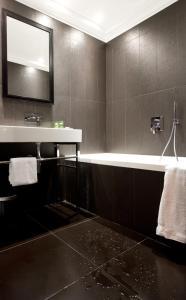 A bathroom at Le Mathurin Hotel & Spa