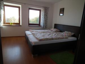 Postel nebo postele na pokoji v ubytování Penzion Výhledy na Brdy