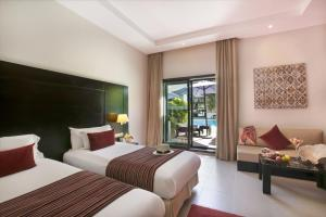 A bed or beds in a room at Kech Boutique Hotel & Spa