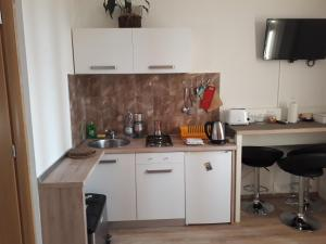 A kitchen or kitchenette at Guest House ZoNa