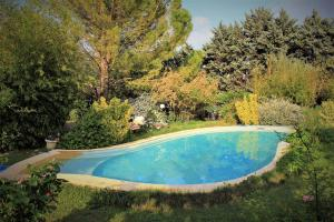 The swimming pool at or near Gites le Pimayon