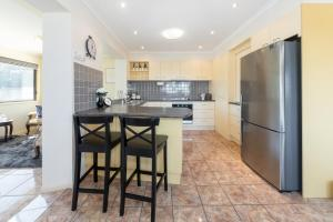 A kitchen or kitchenette at Affordable Family Getaway