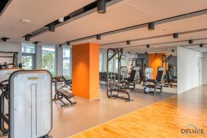 The fitness center and/or fitness facilities at Two Bedroom Apartment with Balcony in BlueWaters Residence 7 by Deluxe Holiday Homes