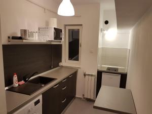 A kitchen or kitchenette at Marcos Apartments
