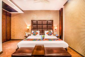 A bed or beds in a room at FabHotel Jasmine Boutique Jasola
