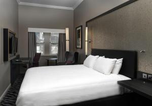 A bed or beds in a room at Doubletree by Hilton Edinburgh City Centre