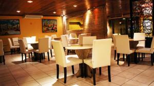 A restaurant or other place to eat at Hotel Aconchego
