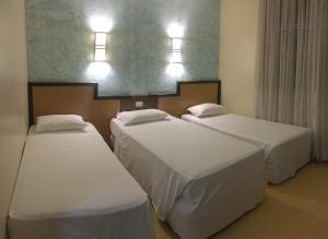 A bed or beds in a room at Master Express Lima e Silva - Cidade Baixa