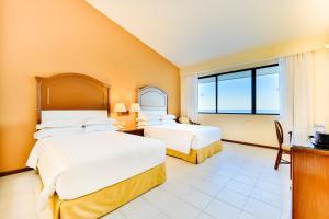 Cama o camas de una habitación en Occidental Tucancún - All Inclusive