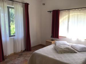 Un ou plusieurs lits dans un hébergement de l'établissement Maison de vacances sud Ardèche