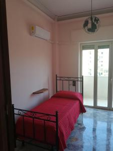 A bed or beds in a room at La Contessa Apartment