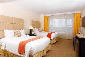 Cama ou camas em um quarto em Sea View Hotel