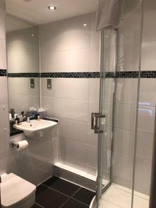 A bathroom at Stonefield Castle Hotel 'A Bespoke Hotel'