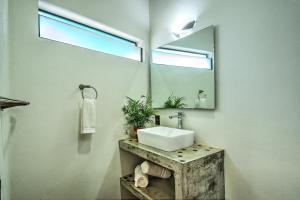 A bathroom at CASA KANELO