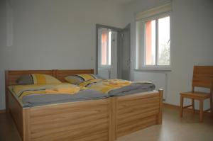 A bed or beds in a room at Sport Tourist Hostel Weißenfels