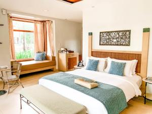 A bed or beds in a room at Misibis Bay