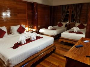 A bed or beds in a room at Chaipura Kc Resort