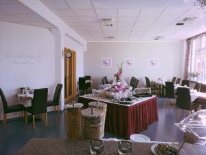 Ein Restaurant oder anderes Speiselokal in der Unterkunft Hotel Zur Alten Druckerei
