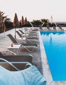 The swimming pool at or near Ecoxenia
