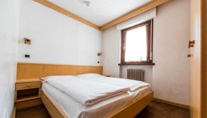 Letto o letti in una camera di Residence Contrin