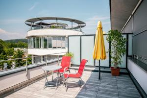A balcony or terrace at AllYouNeed Hotel Klagenfurt