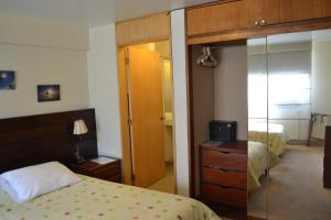 A bed or beds in a room at Suite Service Apart Hotel