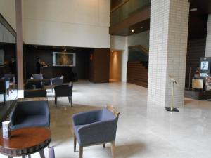 The lobby or reception area at Hotel Bestland