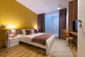 Кровать или кровати в номере Wellness Apartments Hamberger