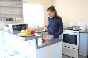 A kitchen or kitchenette at Les Troupes Apartments