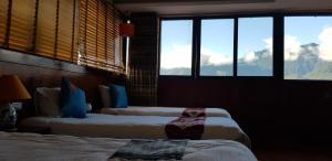 Uma cama ou camas num quarto em Anise Sapa Hotel