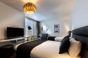 A bed or beds in a room at Brighton Savoy Hotel