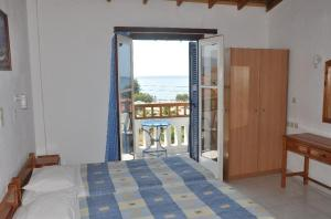 Ένα ή περισσότερα κρεβάτια σε δωμάτιο στο Villa Maria