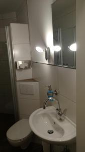 Ein Badezimmer in der Unterkunft Nobis Krug