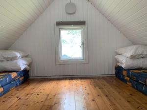 A bed or beds in a room at Tangloppen Camping & Cottages