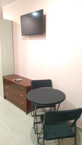 Телевизор и/или развлекательный центр в Гостевой дом Камелия