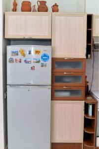 A cozinha ou cozinha compacta de Cosy Apartment