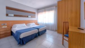 Cama o camas de una habitación en Vivero Playa