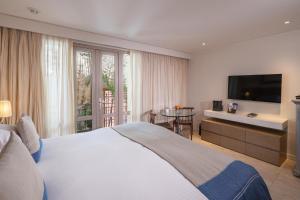 Cama o camas de una habitación en Sofitel Legend Santa Clara Cartagena