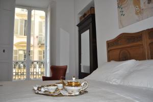 A bed or beds in a room at La Dimora di Sara - Provenza