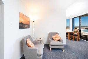 A seating area at Beachpoint, Unit 303, 28 North Street
