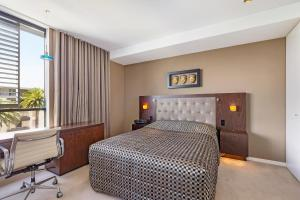 A bed or beds in a room at Camperdown Self-Contained Modern One-Bedroom Apartments