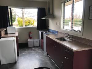 A kitchen or kitchenette at Twizel Holiday Park
