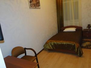 A bed or beds in a room at Stariy Gorod
