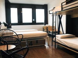 A bed or beds in a room at Generator Paris