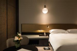 A bed or beds in a room at Nobu Hotel Shoreditch