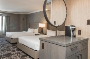 A bed or beds in a room at Kananaskis Mountain Lodge, Autograph Collection
