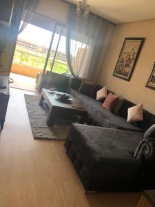 A seating area at New apartment Prestigia golf city