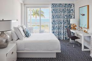 A bed or beds in a room at Isla Bella Beach Resort & Spa - Florida Keys